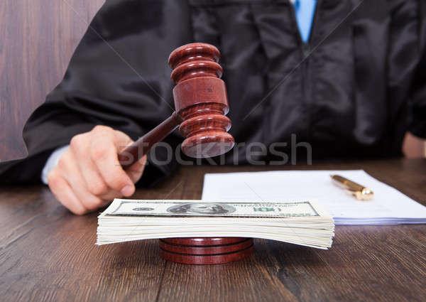 Judge Hitting Mallet On Banknotes Stock photo © AndreyPopov