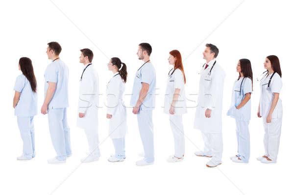 Médico pessoal em pé fila grande Foto stock © AndreyPopov