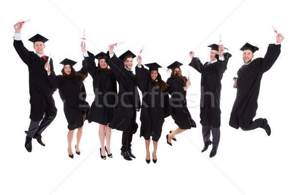 Happy rejoicing group of multiethnic graduates Stock photo © AndreyPopov