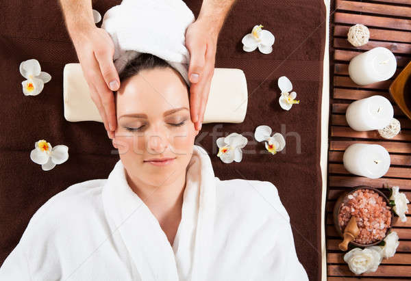 Young Woman Receiving Head Massage At Spa Stock photo © AndreyPopov