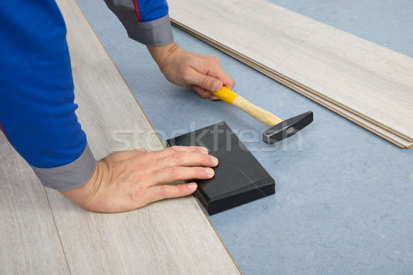 Stock photo: Close-up Of A Worker Assembling Laminate Floor