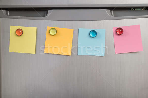 Stock photo: Refrigerator With Colorful Notes