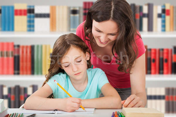 Mother And Daughter Studying In Library Stock photo © AndreyPopov