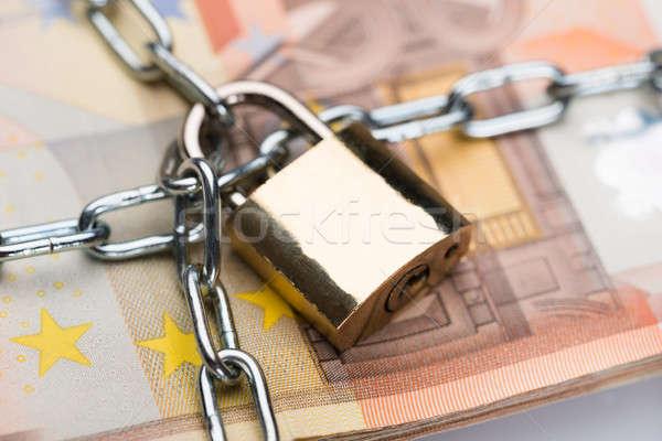 Chain And Padlock Around Euro Banknotes Stock photo © AndreyPopov