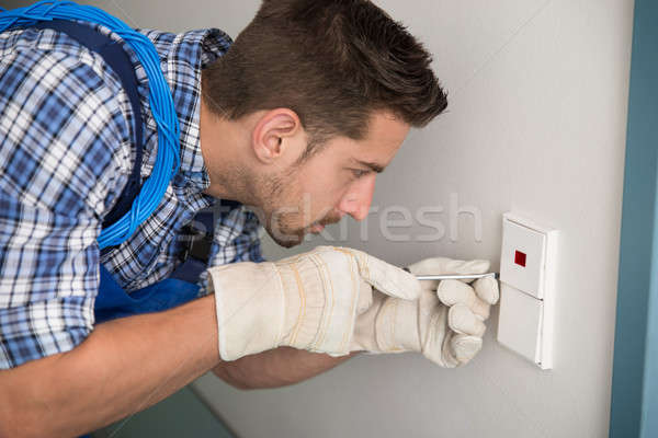 Man Repairing Light Switch At Home Stock photo © AndreyPopov