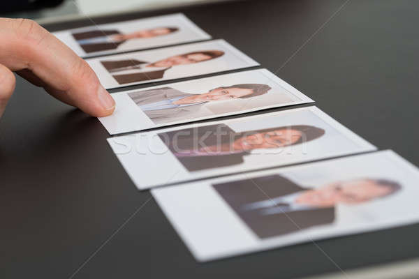 Person Choosing Photograph Of A Candidate Stock photo © AndreyPopov