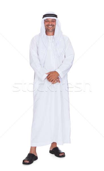 Uśmiechnięty arabski człowiek stałego biały Zdjęcia stock © AndreyPopov