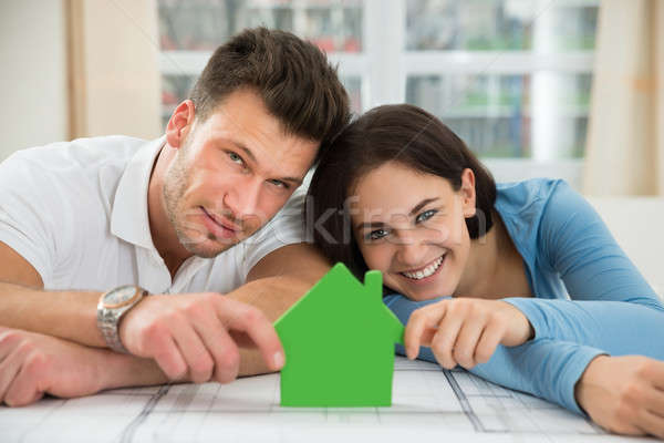 Young Couple Holding Green House Model Stock photo © AndreyPopov