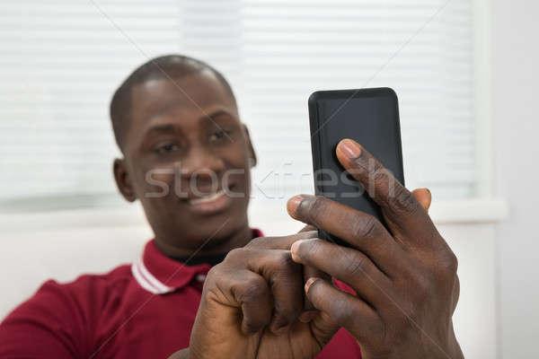 Stockfoto: Jonge · afrikaanse · man · mobieltje
