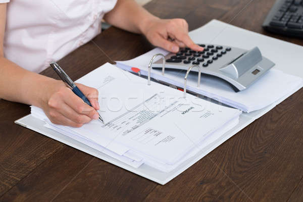 Accountant Calculating Bills Stock photo © AndreyPopov