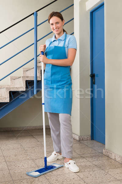 Female Janitor With Mop Stock photo © AndreyPopov