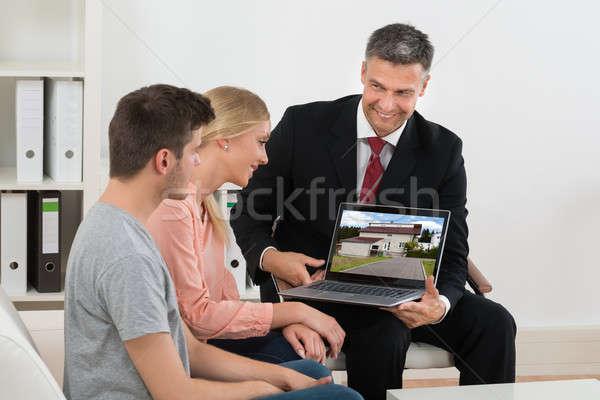 агент по продаже недвижимости дома ноутбука пару зрелый Сток-фото © AndreyPopov
