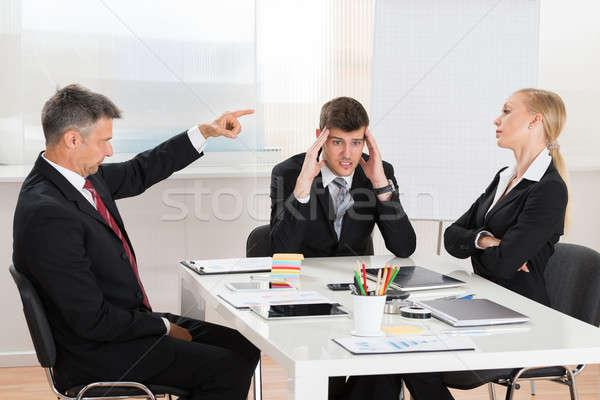 üzletember veszekedik kettő munkatársak érett iroda Stock fotó © AndreyPopov