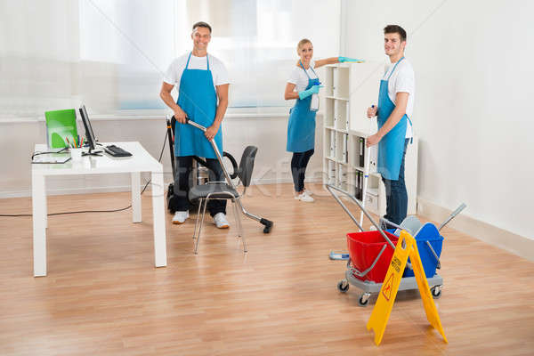 Janitors In Blue Apron Cleaning Office Stock photo © AndreyPopov