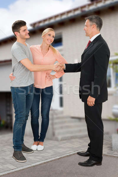 Estate Agent Shaking Hands With Couple Stock photo © AndreyPopov
