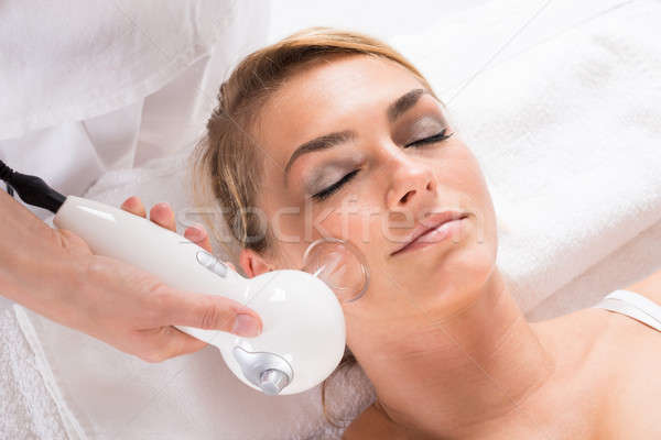 Woman Receiving Cellulite Vacuum Therapy On Face Stock photo © AndreyPopov