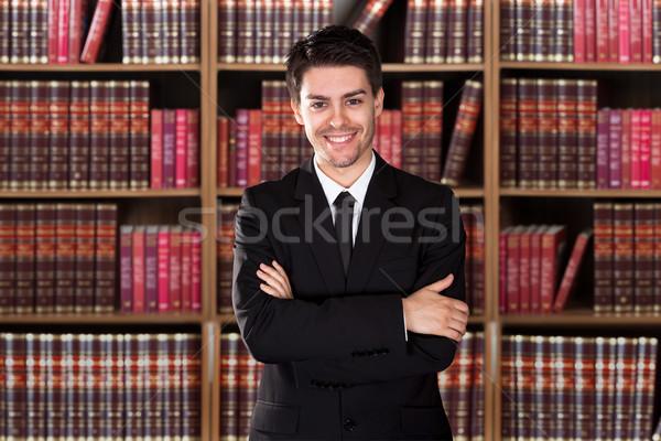 Avvocato piedi braccia incrociate ritratto maschio scaffale Foto d'archivio © AndreyPopov