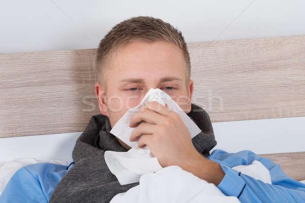 Homme froid moucher portrait jeune homme nez Photo stock © AndreyPopov