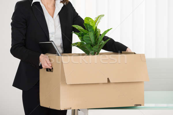 Businesswoman Carrying Her Belongings Stock photo © AndreyPopov