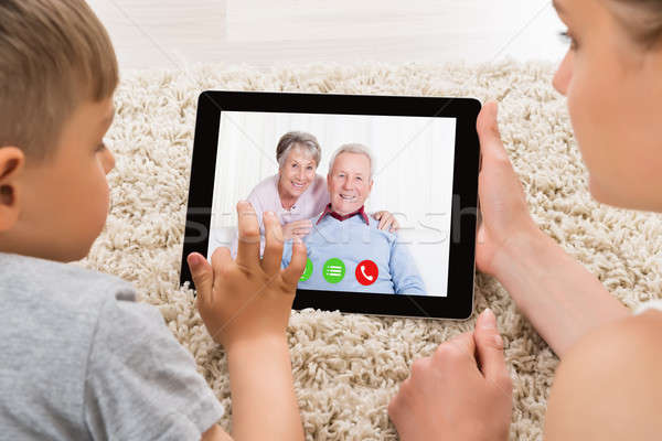 Mother And Son Videoconferencing On Digital Tablet Stock photo © AndreyPopov