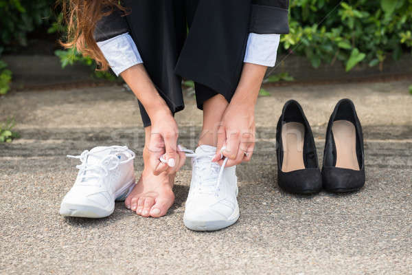 Businesswoman Changing Shoes Stock photo © AndreyPopov