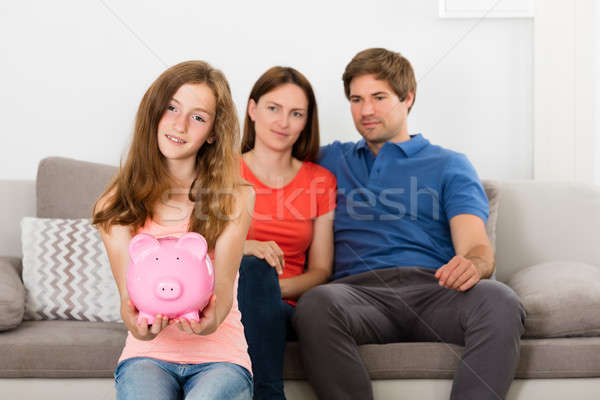 Girl Holding Piggybank Stock photo © AndreyPopov