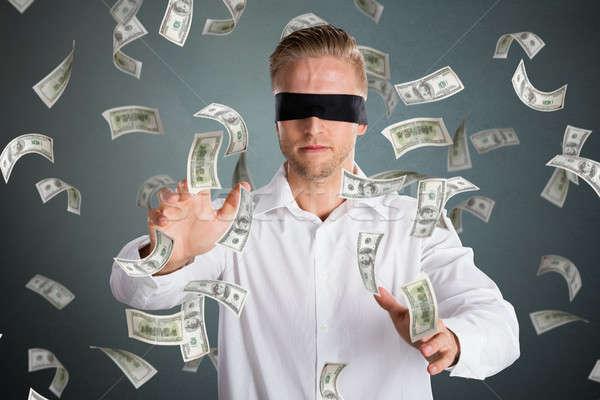 Geblinddoekt zakenman vallen geld jonge grijs Stockfoto © AndreyPopov