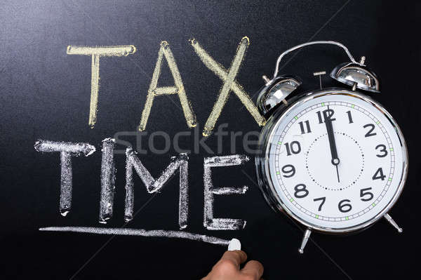 Despertador imposto tempo lousa negócio Foto stock © AndreyPopov