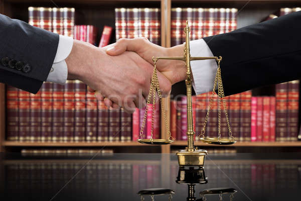 Justice Scale With Judge And Client Shaking Hands Stock photo © AndreyPopov