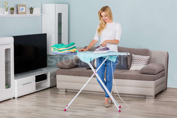 Woman Ironing Clothes On Ironing Board Stock photo © AndreyPopov