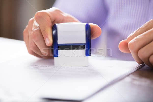 Close-up Of A Person Stamping On Document Stock photo © AndreyPopov