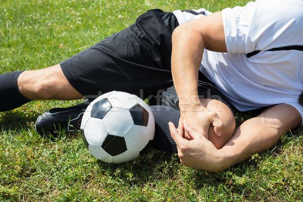 Erkek futbolcu diz hasar Stok fotoğraf © AndreyPopov