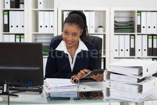 Smiling Businesswoman Calculating Bill Stock photo © AndreyPopov