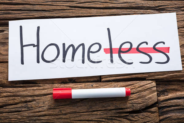 Homeless Text On Paper With Strike Out Less Word Stock photo © AndreyPopov