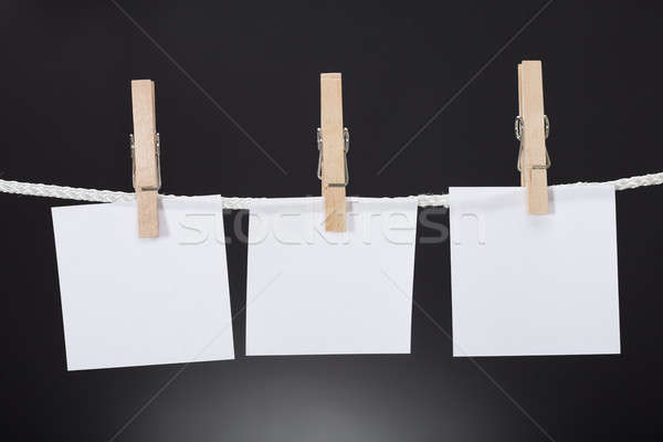 White Paper Cards Hanging On Rope Attached With Clothespins Stock photo © AndreyPopov