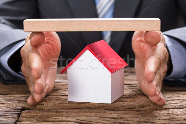 Empresário modelo casa mãos Foto stock © AndreyPopov