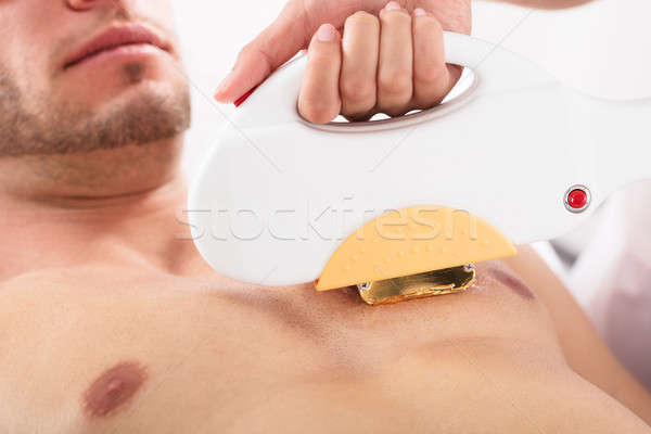 Man Getting A Laser Skin Treatment Stock photo © AndreyPopov
