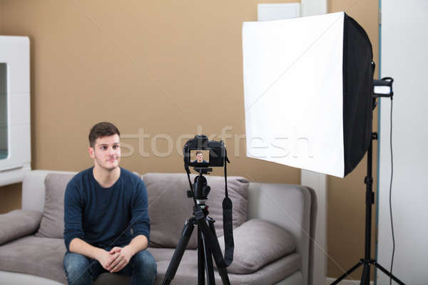 Male Blogger Recording Video With Camera At Home Stock photo © AndreyPopov