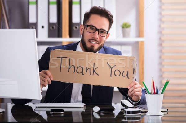 üzletember tart karton köszönjük szöveg mosolyog Stock fotó © AndreyPopov