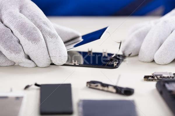 Osoby uszkodzony ekranu telefonu komórkowego Zdjęcia stock © AndreyPopov