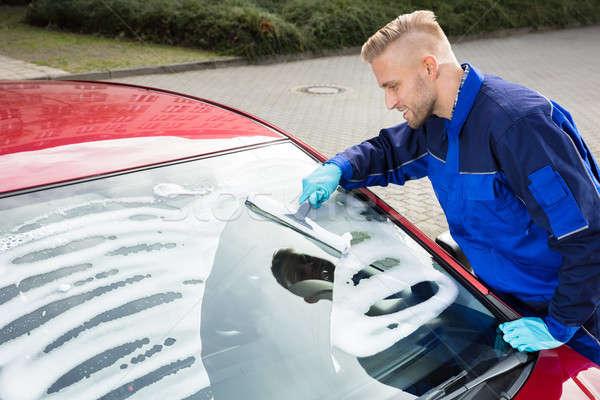 Trabalhador lavagem pára-brisas carro água trabalhar Foto stock © AndreyPopov