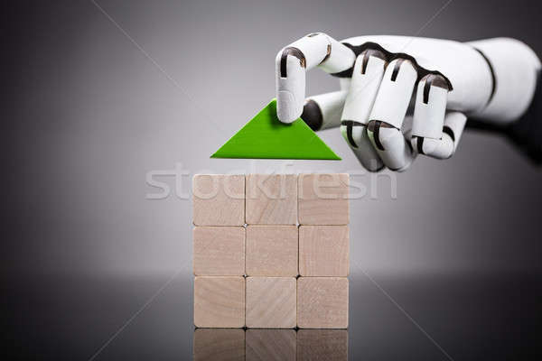 Stock photo: Robot Building House Of Wooden Block