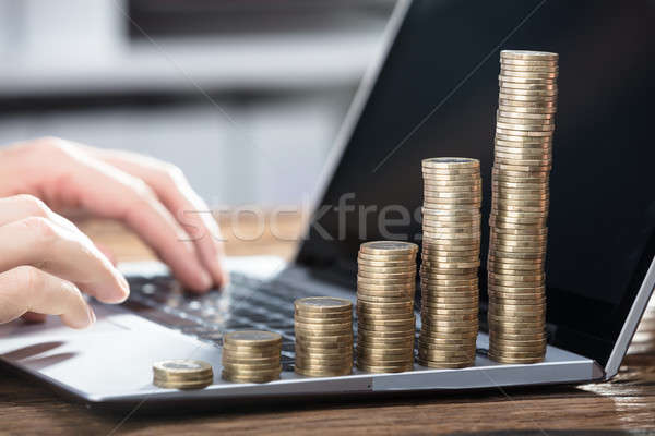 Businessperson's Hand Working On Laptop Stock photo © AndreyPopov