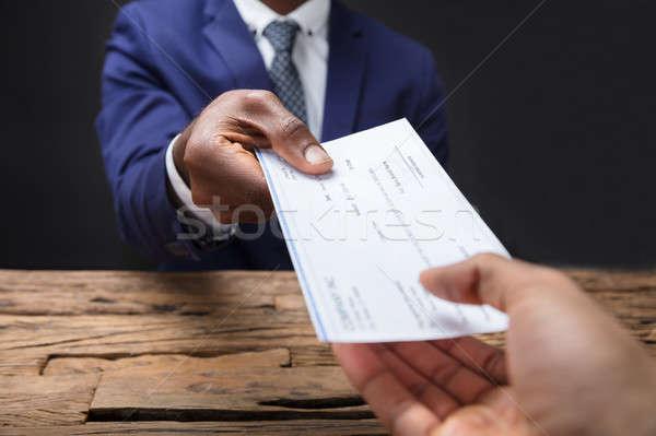 Affaires chèque collègue main bois Photo stock © AndreyPopov