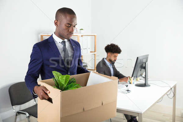 Businessman Moving Out With Cardboard Box From Office Stock photo © AndreyPopov