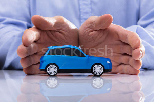 Person Protecting Small Car Stock photo © AndreyPopov