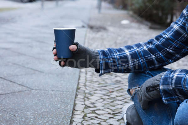 Beggar Holding Disposable Cup Stock photo © AndreyPopov