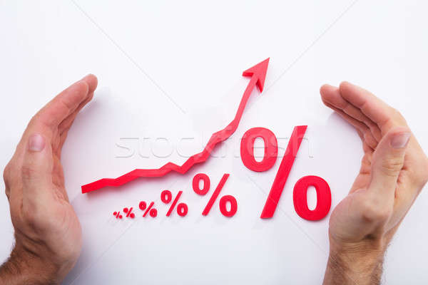Human Hand Protecting Percentage Symbol And Arrow Sign Stock photo © AndreyPopov