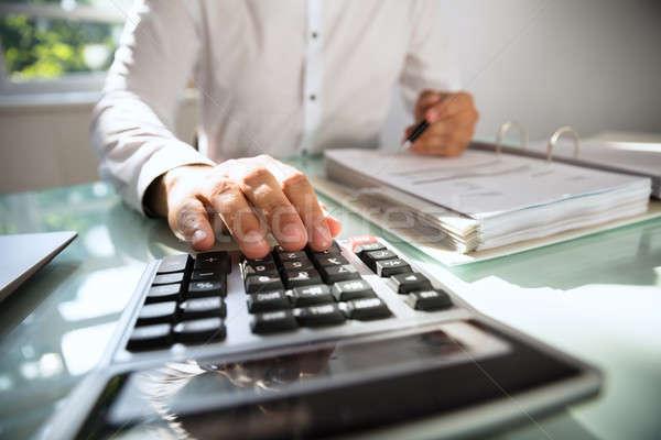 Businessman calculating bill Stock photo © AndreyPopov