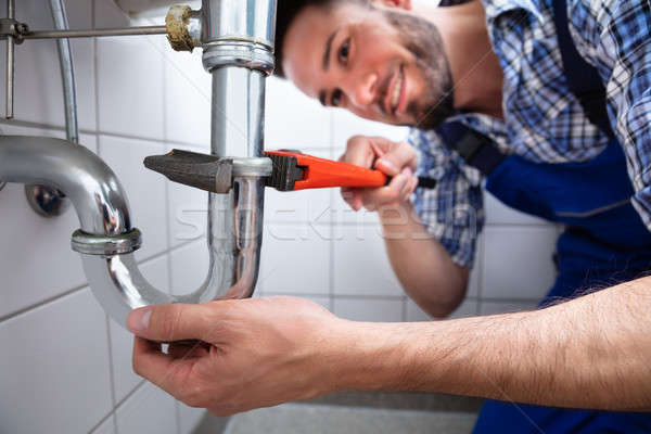 Plumber Repairing Sink In Bathroom Stock photo © AndreyPopov
